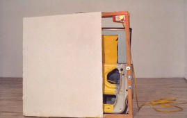 1989 Car door, Sheetrock, cloth, oil, acrylic and latex paint, orange light, yellow electrical cord, wood, hardware approx 51 in