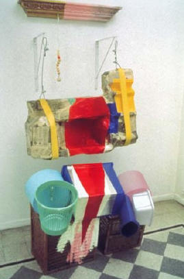 2001 Molding, papier mâché over styrofoam, acrylic and oil paint, aluminum/tar flashing, plastic containers, nylon webbing, aircraft cable, beads, two baskets 81 x 4 x 39 in 205.7 x 10.2 x 99.1 cm