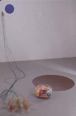 1996 Fish bowl,candles,glass light shades,plastic fruit, clothesline wire,hardware,rubber mat,acrylic and oil paint 64 x 120 x 62 in 162.6 x 304.8 x 157.5 cm